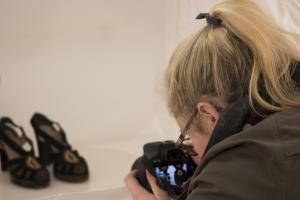 A student photographs objects for the collections database (photo credit: Katherine Craig)