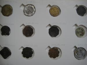 Storage tray for tokens in the collection (created 2013).